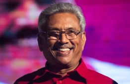 (FILES) In this file photo taken on November 13, 2019 Sri Lanka Podujana Peramuna (SLPP) party presidential candidate Gotabaya Rajapaksa smiles during a campaign rally in Homagama ahead of the November 16 presidential election. Sri Lanka's former wartime defence secretary Gotabaya Rajapaksa has been elected president, his spokesman said on November 17 following a fiercely fought election seven months after Islamist attacks killed 269 people. Jewel SAMAD / AFP