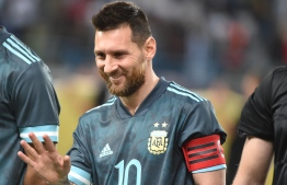 Argentina's forward Lionel Messi greets a fan following the friendly football match between Brazil and Argentina at the King Saud University stadium in the Saudi capital Riyadh on November 15, 2019. (Photo by Fayez Nureldine / AFP)