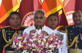 Sri Lanka's president Gotabaya Rajapaksa (C) speaks during his swearing-in ceremony at the Ruwanwelisaya temple in Anuradhapura on November 18, 2019. - Sri Lanka's new president Gotabaya Rajapaksa was sworn in November 18 at a Buddhist temple revered by his core Sinhalese nationalist supporters, following an election victory that triggered fear and concern among the island's Tamil and Muslim minority communities. (Photo by Lakruwan WANNIARACHCHI / AFP)