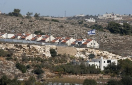 "The Israeli settlement of Kyryat Arba in pictured in the occupied West Bank near the Palestinian town of Hebron on November 19, 2019. - Israeli Prime Minister Benjamin Netanyahu said a US statement deeming Israeli settlement not to be illegal ""rights a historical wrong"". But the Palestinian Authority decried the US policy shift as ""completely against international law"". Both sides were responding to an announcement by US Secretary of State Mike Pompeo saying that Washington ""no longer considers Israeli settlements to be ""inconsistent with international law"". (Photo by HAZEM BADER / AFP)"