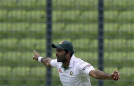 (FILES) In this file photo taken on May 6, 2015 Bangladeshi cricketer Shahadat Hossain reacts after taking a catch to dismiss Pakistan batsman Sami Aslam during the first day of the second cricket Test match between Bangladesh and Pakistan at The Sher-e-Bangla National Cricket Stadium in Dhaka. - The Bangladesh Cricket Board on November 19 banned former national team fast bowler Shahadat Hossain for five years after he assaulted a teammate in a match. The temperamental Shahadat was reported by umpires after he was seen to slap and kick a teammate during a National Cricket League match on November 17. (Photo by Munir UZ ZAMAN / AFP)