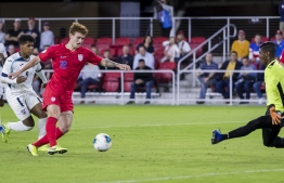 (FILES) In this file photo Josh Sargent #19 of the United States shoots the ball against Nelson Johnston #21 of Cuba during the first half at Audi Field on October 11, 2019 in Washington, DC. - Jordan Morris and teenager Josh Sargent scored two goals apiece as the United States eased into the final four of the CONCACAF Nations League on Tuesday with a 4-0 win over Cuba. (Photo by Scott Taetsch / GETTY IMAGES NORTH AMERICA / AFP)