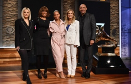 (L-R)Bebe Rexha, Gayle King, Alicia Keys, Recording Academy president and CEO Deborah Dugan and Chair of the Board of Trustees of the Recording Academy Harvey Mason Jr. pose during the 62nd Grammy Awards Nominations Conference at CBS Broadcast Center on November 20, 2019 in New York City. (Photo by Angela Weiss / AFP)