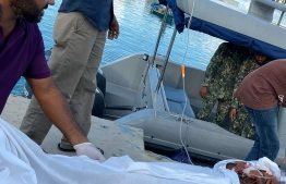 Coast guard transporting the man who was stabbed from AA.Maalhos. PHOTO: MNDF