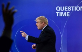 "A handout picture taken and released by the BBC on November 22, 2019, shows Britain's Prime Minister Boris Johnson participating on the BBC's Question Time 'Leaders Special' television show, from Sheffield, northern England, that is set to feature the leaders of Britain's four main political parties. - Britain will go to the polls on December 12, 2019 to vote in a pre-Christmas general election. (Photo by JEFF OVERS / various sources / AFP) / RESTRICTED TO EDITORIAL USE - MANDATORY CREDIT "" AFP PHOTO / JEFF OVERS-BBC "" - NO MARKETING NO ADVERTISING CAMPAIGNS - DISTRIBUTED AS A SERVICE TO CLIENTS TO REPORT ON THE BBC PROGRAMME OR EVENT SPECIFIED IN THE CAPTION - NO ARCHIVE - NO USE AFTER **DECEMBER 12, 2019** /"