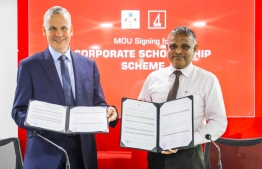 BML's CEO and Managing Director Tim Sawyer (L) and Higher Education Minister Dr Ibrahim Hassan sign MOU for Corporate Scholarship Scheme on November 28, 2019. PHOTO/BML