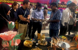 Management from Crossroads, Singha Estate Developers visit and inspect the local handicrafts and speak with the local artists at Fannu Expo. PHOTO: MARCOMMS