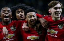 Manchester United's English midfielder Jesse Lingard celebrates with teammates after scoring a goal during the UEFA Europa League group L football match between Astana and Manchester United in Nur-Sultan on November 28, 2019. (Photo by stringer / AFP)