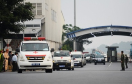 Vehicles carrying some of the remains of the 39 UK truck victims leave Noi Bai airport in Hanoi on November 27, 2019 - The first remains of the 39 people found dead in a truck in Britain last month arrived in Vietnam early, an airport security source said. (Photo by Nhac NGUYEN / AFP)