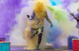 A participant is engulfed in colour during the Ooredoo Color Run 2019 in reclaimed suburb Hulhumale'. PHOTO: OOREDOO MALDIVES