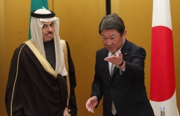 Japan's Foreign Minister Toshimitsu Motegi (R) meets with Saudi Arabia's Foreign Minister Prince Faisal bin Farhan at the G20 Foreign Ministers meeting in Nagoya on November 22, 2019. (Photo by KIM KYUNG-HOON / POOL / AFP)
