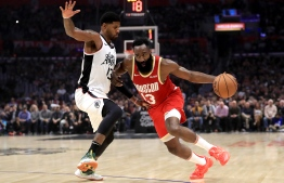 (FILES) In this file photo taken on November 22, 2019 James Harden #13 of the Houston Rockets dribbles past Paul George #13 of the Los Angeles Clippers during the first half of a game at Staples Center in Los Angeles, California. - James Harden tied Michael Jordan for the third most 60-point performances in NBA history on November 30, 2019 as the Houston Rockets blasted the last-place Atlanta Hawks 158-111. (Photo by Sean M. Haffey / GETTY IMAGES NORTH AMERICA / AFP)