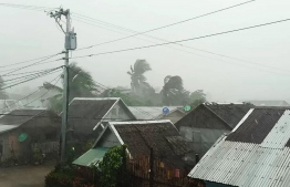This handout image taken and received on December 2, 2019 courtesy of Gladys Vidal shows heavy rains and moderate wind from Typhoon Kammuri battering houses in Gamay town, Northern Samar province. The Philippines was braced for powerful Typhoon Kammuri as the storm churned closer, forcing evacuations and threatening plans for the Southeast Asian Games events near the capital Manila.  Handout / Courtesy of Gladys Vidal / AFP