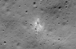 This handout image released by NASA, and taken by the Lunar Reconnaissance Orbiter Camera team shows the Vikram Lander impact point. - A NASA satellite orbiting the Moon has found India's Vikram lander which crashed on the lunar surface in September, the US space agency said Monday. NASA released an image taken by its Lunar Reconnaissance Orbiter (LRO) that showed the site of the impact (September 6 in India and September 7 in the US), and associated debris field of the spacecraft, with parts scattered over almost two dozen locations spanning several kilometers. (Photo by Handout / NASA / AFP) /
