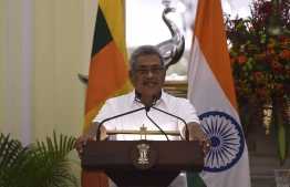 Sri Lanka's President Gotabaya Rajapaksa looks on during a joint media briefing at the Hyderadad House in New Delhi on November 29, 2019. (Photo by MONEY SHARMA / AFP)