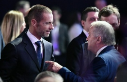 UEFA's president Aleksander Ceferin (L) arrives for the UEFA Euro 2020 football competition final draw in Bucharest on November 30, 2019. (Photo by Fabrice COFFRINI / AFP)