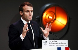 French President Emmanuel Macron gestures as he delivers a speech during the annual conference of the French maritime economy in Montpellier, southern France, on December 3, 2019. (Photo by Guillaume HORCAJUELO / POOL / AFP)