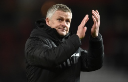 Manchester United's Norwegian manager Ole Gunnar Solskjaer applauds supporters as he leaves after the English Premier League football match between Manchester United and Aston Villa at Old Trafford in Manchester, north west England, on December 1, 2019. - The game finished 2-2. (Photo by Oli SCARFF / AFP) / RESTRICTED TO EDITORIAL USE. No use with unauthorized audio, video, data, fixture lists, club/league logos or 'live' services. Online in-match use limited to 120 images. An additional 40 images may be used in extra time. No video emulation. Social media in-match use limited to 120 images. An additional 40 images may be used in extra time. No use in betting publications, games or single club/league/player publications. /