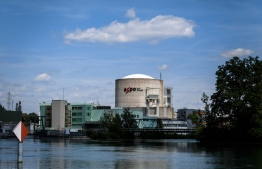 This picture taken on July 9, 2019, shows a general view of Switzerland's Beznau nuclear plant near Dottingen. - Europe's oldest functioning nuclear reactor, at Switzerland's Beznau plant, will turn 50 next week -- a lifespan deemed dangerously long by environmentalists who are demanding that it be shut down immediately. Commercial operation began at the plant in the northern canton of Aargau, near the German border, on December 9, 1969 -- back when The Beatles were still together and a man had just walked on the Moon. (Photo by Fabrice COFFRINI / AFP)