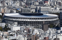 The new 1.4 billion USD main venue for the 2020 Tokyo Olympic Games is pictured after being officially completed in Tokyo on November 30, 2019. - The five-story stadium, designed by renowned Japanese architect Kengo Kuma, will seat 60,000 fans and nods to traditional techniques through the prominent use of wood. (Photo by CHARLY TRIBALLEAU / AFP)