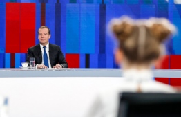 Russian Prime Minister Dmitry Medvedev gives a live interview on the annual results of the government work to journalists of Russia's television channels in Moscow on December 5, 2019. (Photo by Dmitry Astakhov / SPUTNIK / AFP)