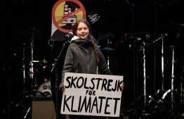 Swedish climate activist Greta Thunberg delivers a speech after a mass climate march to demand urgent action on the climate crisis from world leaders attending the COP25 summit, in Madrid, on December 6, 2019. - Thousands of activists from around the globe will simultaneously hit the streets of Madrid and Santiago on December 6, 2019. Teen eco-warrior Greta Thunberg -- who refuses to fly because of the carbon emissions involved -- is expected to join the rally after making a nearly three-week journey across the Atlantic by catamaran. She made a surprise appearance at the climate conference after she arrived in Madrid following a 10-hour overnight train trip from Lisbon, joining dozens of other youths in sit-in. (Photo by PIERRE-PHILIPPE MARCOU / AFP)