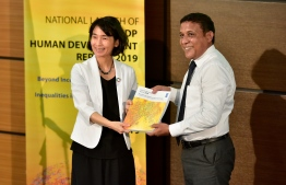 Minister of Planning and Infrastructure Mohamed Aslam (R) and UNDP Resident Representative to Maldives Akiko Fujii during the national launch of the global Human Development Report 2019 by the United Nations Development Programme. PHOTO: NISHAN ALI / MIHAARU