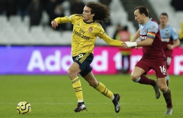 Arsenal's French midfielder Matteo Guendouzi (L) vies with West Ham United's English midfielder Mark Noble during the English Premier League football match between West Ham United and Arsenal at The London Stadium, in east London on December 9, 2019. (Photo by Adrian DENNIS / AFP) / RESTRICTED TO EDITORIAL USE. No use with unauthorized audio, video, data, fixture lists, club/league logos or 'live' services. Online in-match use limited to 120 images. An additional 40 images may be used in extra time. No video emulation. Social media in-match use limited to 120 images. An additional 40 images may be used in extra time. No use in betting publications, games or single club/league/player publications. /