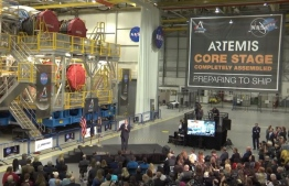 NASA Administrator Jim Bridenstine spoke in front of the first completed core stage of an SLS rocket on Dec. 9, 2019. PHOTO/NASA TV