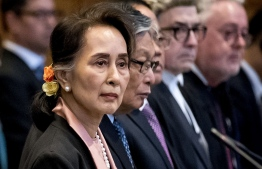 Aung San Suu Kyi listens in court. She is expected to defend her country's military on Wednesday. PHOTO: Koen van Weel/ANP/AFP via Getty Images