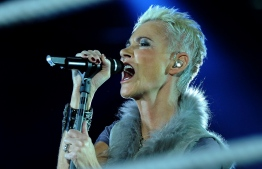 (FILES) This file photo taken on March 19, 2011 shows Swedish singer Marie Fredriksson of the pop group Roxette performing in Cologne, western Germany. - As it was announced on December 10, 2019, Fredriksson died on December 9, 2019 at the age of 61. (Photo by Patrik STOLLARZ / AFP)