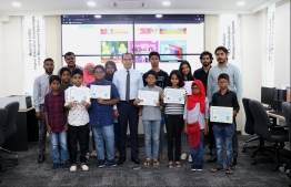 Minister of Communication, Science and Technology Maleeh Jamaal with participants of the 'Hour of Code' session. PHOTO: MINISTRY OF COMMUNICATION, SCIENCE AND TECHNOLOGY
