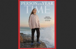 """This handout image released on December 11, 2019 courtesy of Time shows the Time person of the Year December 23/December 30, 2019 cover with Greta Thunberg. - Greta Thunberg, the Swedish teenager who became the voice of conscience for a generation facing the climate change emergency, was announced December 11, 2019 as Time magazine's 2019 Person of the Year. The 16-year-old first hit the headlines for her solo strike against global warming outside Sweden's parliament last year.""""We can't just continue living as if there was no tomorrow, because there is a tomorrow. That is all we are saying,"""" Thunberg told Time. (Photo by Evgenia ARBUGAEVA / TIME / AFP) / RESTRICTED TO EDITORIAL USE - MANDATORY CREDIT """"AFP PHOTO /EVGENIA ARBUGAEVA FOR TIME """" - NO MARKETING - NO ADVERTISING CAMPAIGNS - DISTRIBUTED AS A SERVICE TO CLIENTS"""