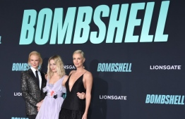 """(L-R) Australian actress Nicole Kidman, Australian actress Margot Robbie and South African actress Charlize Theron arrive for Lionsgate's special screening of """"Bombshell"""" at the Regency Village Theatre in Westwood, California on December 10, 2019. (Photo by LISA O'CONNOR / AFP)"""