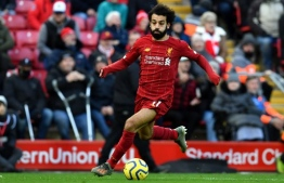 Liverpool's Egyptian midfielder Mohamed Salah controls the ball during the English Premier League football match between Liverpool and Watford at Anfield in Liverpool, north west England on December 14, 2019. (Photo by Paul ELLIS / AFP) / RESTRICTED TO EDITORIAL USE. No use with unauthorized audio, video, data, fixture lists, club/league logos or 'live' services. Online in-match use limited to 120 images. An additional 40 images may be used in extra time. No video emulation. Social media in-match use limited to 120 images. An additional 40 images may be used in extra time. No use in betting publications, games or single club/league/player publications. /
