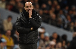 Manchester City's Spanish manager Pep Guardiola reacts on the touchline during the English Premier League football match between Manchester City and Manchester United at the Etihad Stadium in Manchester, north west England, on December 7, 2019. PHOTO: OLI SCARFF