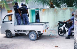 Officers from Maldives Police Service in Maduvvari, Raa Atoll, inspecting houses under operation 'Asseyri'. PHOTO: MADUVVARI ONLINE