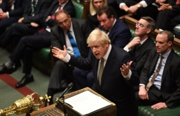 A handout photograph taken and released by the UK Parliament on December 19, 2019, shows Britain's Prime Minister Boris Johnson speaking in the House of Commons in London after the State Opening Of Parliament. - Prime Minister Boris Johnson on Thursday put Britain's departure from the EU at the top of his to-do list, as Queen Elizabeth II read out his plans for government in a parliamentary ceremony following a sweeping election win. (Photo by JESSICA TAYLOR / various sources / AFP) /