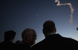 This handout photo released by NASA shows Florida Gov. Ron DeSantis (R), left, Tory Bruno, president and CEO of United Launch Alliance, and NASA Administrator Jim Bridenstine watch as a United Launch Alliance Atlas V rocket with Boeing's CST-100 Starliner spacecraft onbaord launches from Space Launch Complex 41 at Cape Canaveral Air Force Station, Friday, Dec. 20, 2019, from NASA's Kennedy Space Center in Florida. The uncrewed Orbital Flight Test launched at 6:36 a.m. EST and is Starliner's maiden mission to the International Space Station for NASA's Commercial Crew Program. The mission will serve as an end-to-end test of the system's capabilities.  Joel KOWSKY / NASA / AFP