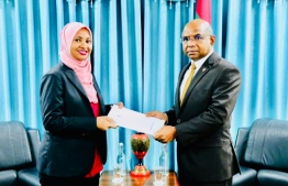 Minister Shahid presenting letter of appointment to Aminath Abdulla Didi as Consul General of the Maldivian Consulate in Thiruvananthapuram, India. PHOTO: FOREIGN MINISTRY