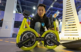The Smacircle S1 folding micro-mobility bike is folded on opening day of the 2020 Consumer Electronics Show (CES) in Las Vegas, Nevada on January 7, 2020. (Photo by DAVID MCNEW / AFP)