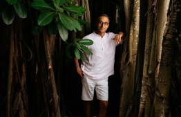 Soneva Fushi is renown for its nurturing philosophy and has successfully preserved much of the island's natural greenery. In this photo, Sonu Shivdasani (CEO and Joint Creative Director of Soneva) stands with one of the island's oldest occupants, a magnificent Banyan tree. PHOTO: SONEVA