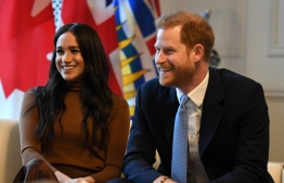 Britain's Prince Harry, Duke of Sussex and Meghan, Duchess of Sussex react during their visit to Canada House in thanks for the warm Canadian hospitality and support they received during their recent stay in Canada,  in London on January 7, 2020. (Photo by DANIEL LEAL-OLIVAS / POOL / AFP)
