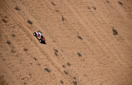 Mini's Spanish drivers Carlos Sainz of Spain and co-driver Lucas Cruz of Spain compete during the Stage 5 of the Dakar 2020 between Al Ula and Ha'il, Saudi Arabia, on January 9, 2020. (Photo by FRANCK FIFE / AFP)
