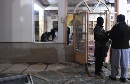 Security officials examine the site after a bomb blast in a mosque in Quetta on January 10, 2020. - At least 10 people were killed and 16 others wounded in a bomb blast during evening prayers at a mosque in southwestern Pakistan on January 10, police and a doctor said. (Photo by BANARAS KHAN / AFP)