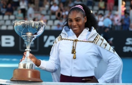 Serena Williams of the US poses with her trophy after winning against Jessica Pegula of the US during their women's singles final match during the Auckland Classic tennis tournament in Auckland on January 12, 2020. (Photo by MICHAEL BRADLEY / AFP)