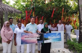 LUX* South Ari Atoll's General Manager (C-L) Jonas Amstad and Minister of Gender, Family and Social Services, Shidatha Shareef (C-L) during the donation ceremony. PHOTO: MINISTRY OF GENDER, FAMILY AND SOCIAL SERVICES