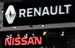 Renault and Nissan automobile logos are pictured during the Brussels Motor Show on January 9, 2020 in Brussels. (Photo by Kenzo TRIBOUILLARD / AFP)