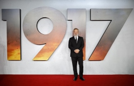 """(FILES) In this file photo taken on December 4, 2019 British film director Sam Mendes poses on the red carpet as he arrives to attend the World premiere and Royal Film Performance of the film """"1917"""" in London in support of the film and TV charity. - Universal's war drama """"1917"""" took command of the North American box office this weekend, riding its Golden Globes success to earn an estimated $36.5 million, industry watcher Exhibitor Relations reported on January 12, 2020. The film's unexpectedly strong showing was timely, with Oscar nominations set to be announced on Monday. Last Sunday it won Golden Globes -- often a predictor of Oscar success -- for both best drama and best director (Sam Mendes). (Photo by Tolga Akmen / AFP)"""