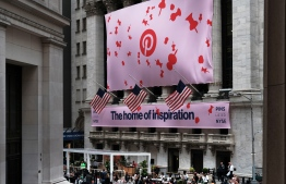 (FILES) In this file photo taken on April 18, 2019, a banner for the online image board Pinterest Inc. hangs from the New York Stock Exchange (NYSE) on the morning that Pinterest Inc. makes its initial public offering in New York City. - Shares in Pinterest popped on January 14, 2020. after a market tracker reported that the online bulletin board surpassed Snapchat to become the third most used social media platform in the US. (Photo by SPENCER PLATT / GETTY IMAGES NORTH AMERICA / AFP)